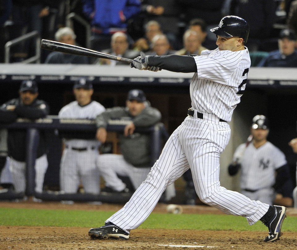 New York Yankees' Raul Ibanez follows through on a home run in the 12th inning in Game 3 of the Yankees' American League division baseball series against the Baltimore Orioles on Wednesday, Oct. 10, 2012, in New York. The Yankees won 3-2. (AP Photo/Bill Kostroun)