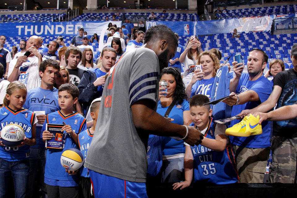 Photo - Fans try to get the attention of James Harden for an autograph before Game 1 in the second round of the NBA playoffs between the Oklahoma City Thunder and L.A. Lakers at Chesapeake Energy Arena in Oklahoma City, Monday, May 14, 2012. Photo by Bryan Terry, The Oklahoman