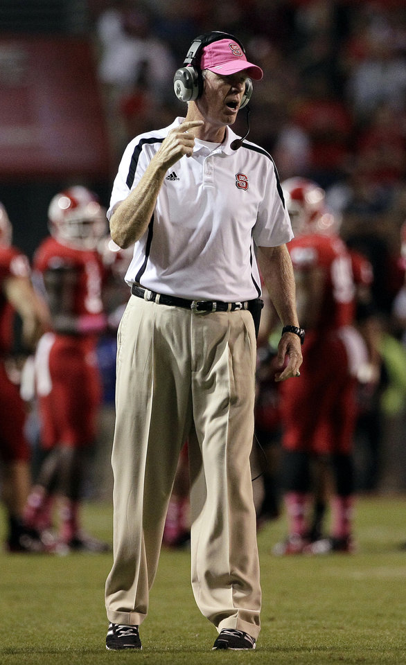 North Carolina State coach Tom O\'Brien calls out during the second half of an NCAA college football game against Florida State in Raleigh, N.C., Saturday, Oct. 6, 2012. North Carolina State won 17-16. (AP Photo/Gerry Broome)