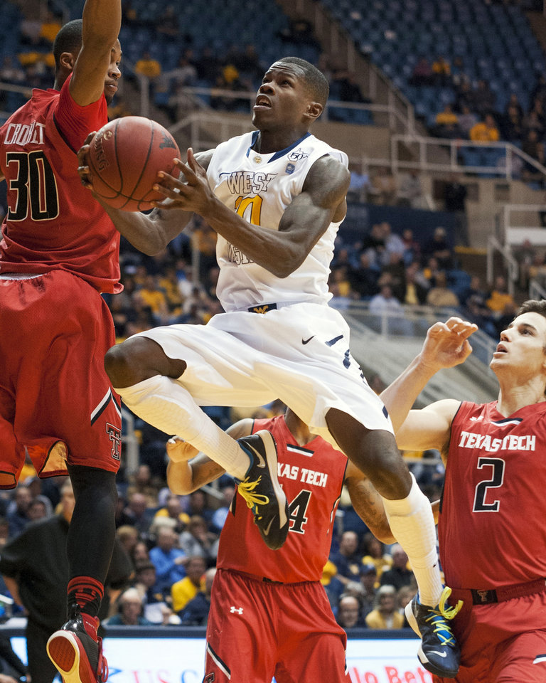 Photo - West Virginia's Eron Harris (10) looks to shoot during the second half of an NCAA college basketball game against Texas Tech, Wednesday, Jan. 22, 2014, in Morgantown, W.Va. West Virginia won 87-81. (AP Photo/Andrew Ferguson)