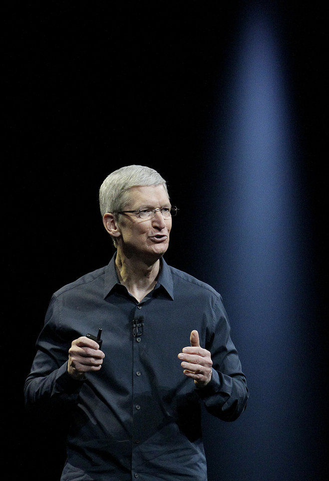 Photo - Apple CEO Tim Cook speaks at the Apple Worldwide Developers Conference in San Francisco, Monday, June 2, 2014. (AP Photo/Jeff Chiu)