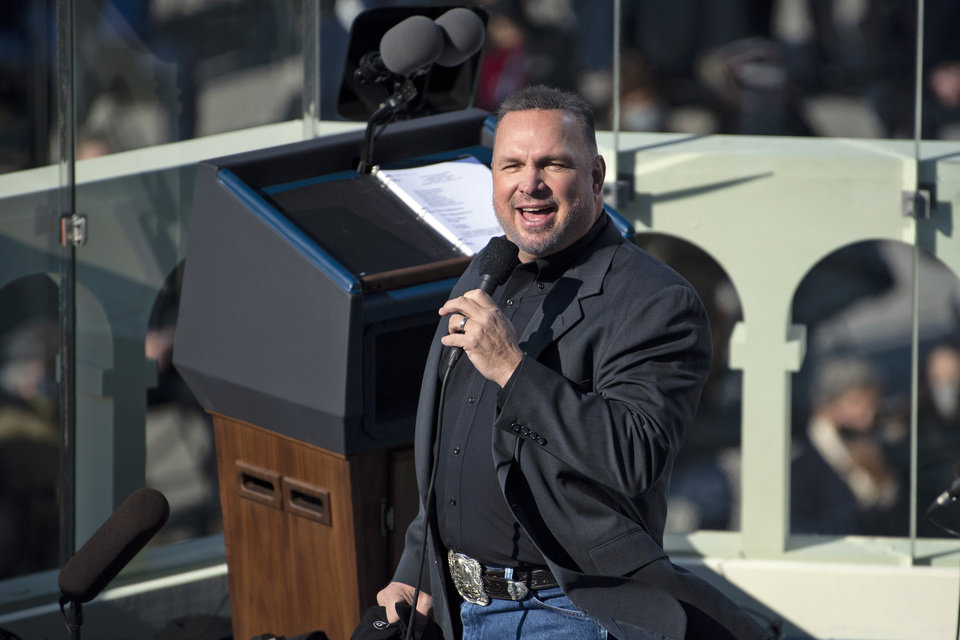 Photo - Country singer Garth Brooks performs during President Joe Biden's inauguration, Wednesday, Jan. 20, 2021, at the U.S. Capitol in Washington. (Caroline Brehman/Pool Photo via AP)