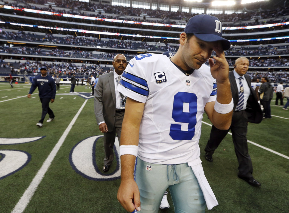 Dallas Cowboys quarterback Tony Romo (9) leaves the field after overtime play of an NFL football game against the New Orleans Saints, Sunday, Dec. 23, 2012 in Arlington, Texas. The Saints won 34-31. (AP Photo/Sharon Ellman) ORG XMIT: CBS143