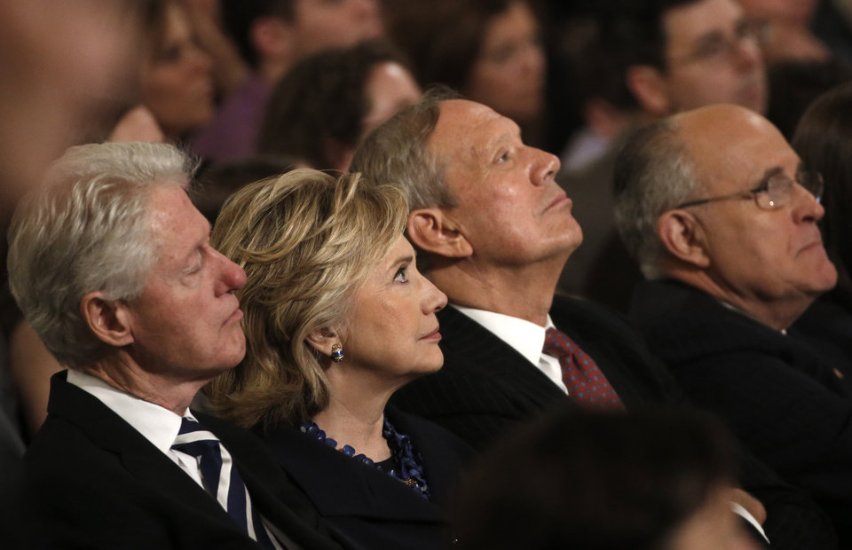 Photo - From left, Former U.S. President Bill Clinton sits with his wife former U.S. Secretary of State Hillary Clinton, former New York Governor George Pataki and former New York City Mayor Rudolph Giuliani during the dedication ceremony at the National September 11 Memorial Museum in New York, Thursday,  May 15, 2014.  (AP Photo/Mike Segar, Pool)