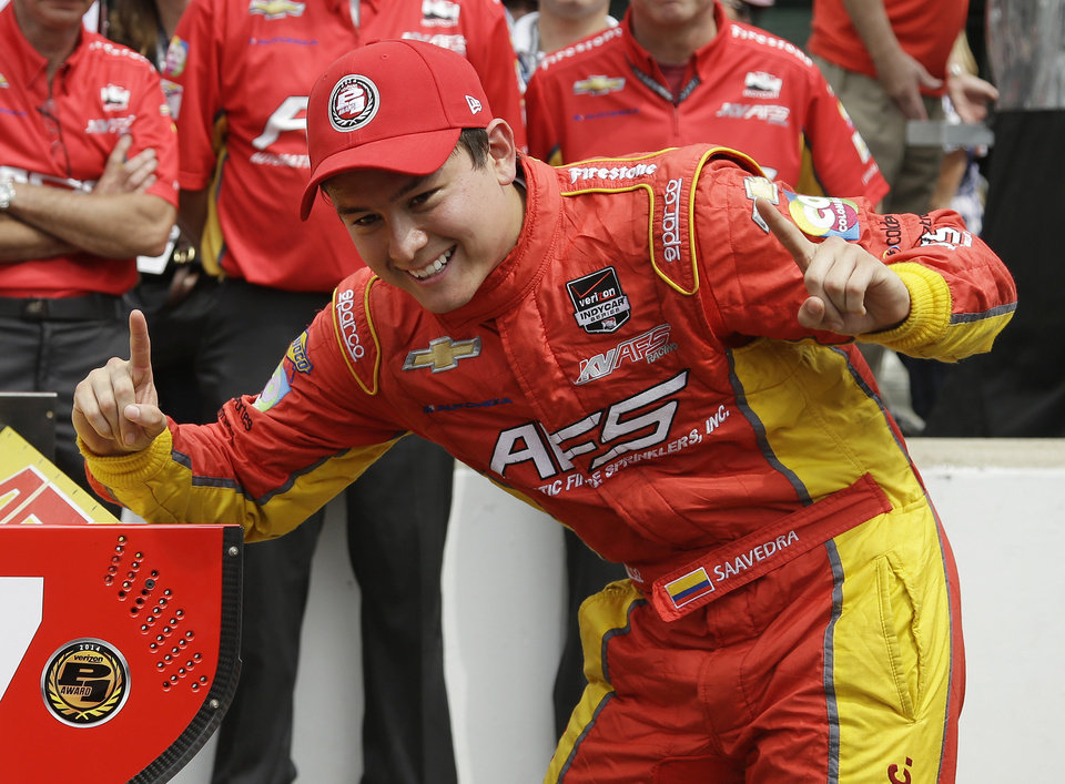 Photo - Sebastian Saavedra, of Colombia, celebrates after winning the pole for inaugural Grand Prix of Indianapolis IndyCar auto race at the Indianapolis Motor Speedway in Indianapolis, Friday, May 9, 2014. (AP Photo/Darron Cummings)