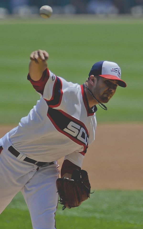 Photo - Chicago White Sox starting pitcher Andre Rienzo delivers during the first inning of an interleague baseball game against the San Diego Padres on Saturday, May 31, 2014, in Chicago. (AP Photo/Matt Marton)