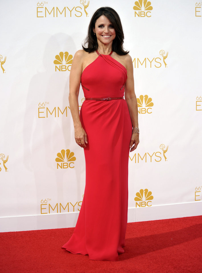 Photo - Julia Louis-Dreyfus arrives at the 66th Annual Primetime Emmy Awards at the Nokia Theatre L.A. Live on Monday, Aug. 25, 2014, in Los Angeles. (Photo by Richard Shotwell/Invision/AP)