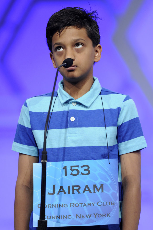 "Photo - Jairam Hathwar, 12, of Corning, N.Y., spells the word ""harpsichord"" during the2015 Scripps National Spelling Bee in Oxon Hill, Md., Wednesday, May 27, 2015. (AP Photo/Cliff Owen)"