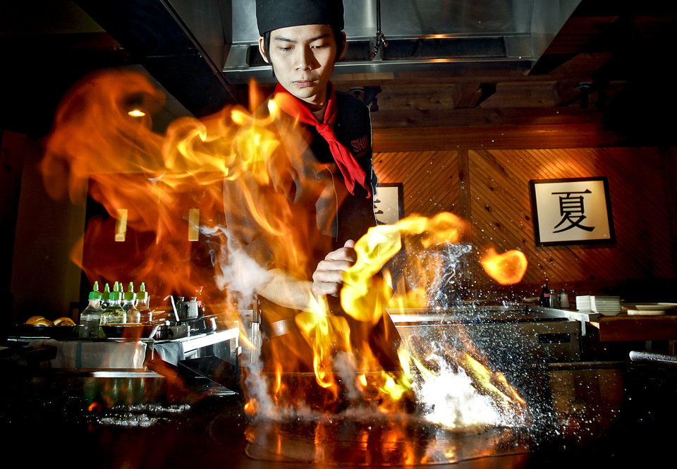 Hibachi chef Vu Tran cooks a meal at Shiki restaurant on Wednesday, July 29, 2009, in Oklahoma City, Okla.   Photo by Chris Landsberger, The Oklahoman