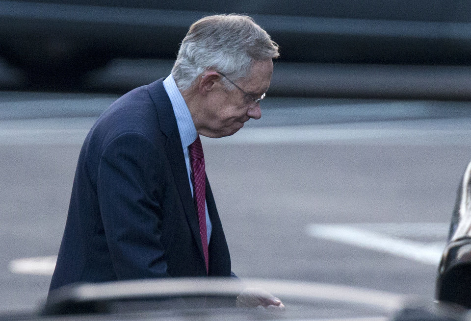 Photo - Senate Majority Leader Harry Reid of Nev. leaves the White House in Washington, Friday, Dec. 28, 2012, after a closed-door meeting between President Barack Obama and Congressional leaders to negotiate the framework for a deal on the fiscal cliff.  The end game at hand, President Barack Obama and congressional leaders made a final stab at compromise Friday to prevent a toxic blend of middle-class tax increases and spending cuts from taking effect at the turn of the new year.  (AP Photo/ Evan Vucci)