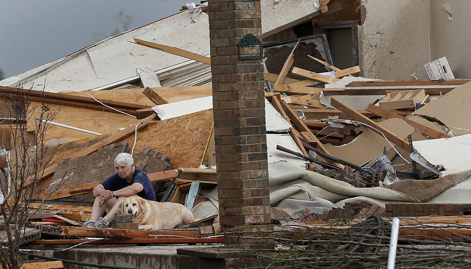 Kay Taylor sits with her dog Bailey in front of her house that was destroyed after the tornado that hit the area near 149th and Drexel on Monday, May 20, 2013 in Oklahoma City, Okla.  Photo by Chris Landsberger, The Oklahoman
