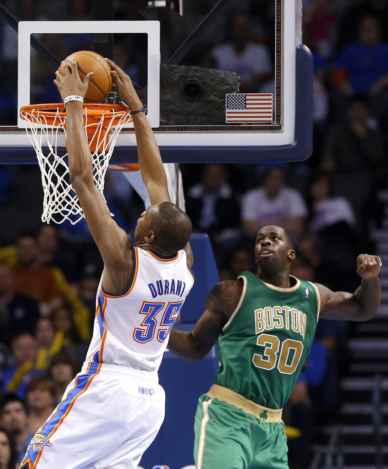 Oklahoma City's Kevin Durant (35) shoots in Boston's Brandon Bass (30) during the NBA game between the Oklahoma City Thunder and the Boston Celtics at the Chesapeake Energy Arena in Oklahoma City, Sunday, March 10, 2013. Photo by Sarah Phipps, The Oklahoman