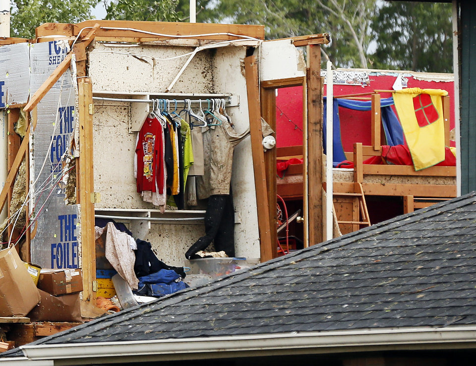 Clothes remain on their hangers in a closet of a home south of SW 149th between Western and Hudson that was hit by the tornado that struck south Oklahoma City and Moore, Okla., Monday, May 20, 2013. Photo by Nate Billings, The Oklahoman