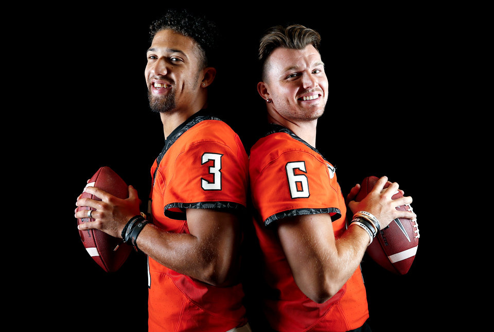 Photo - OSU's Spencer Sanders and Dru Brown pose for a photo during the Oklahoma State Cowboys football media days at Gallagher-Iba Arena in Stillwater, Okla., Saturday, Aug. 3, 2019. [Sarah Phipps/The Oklahoman]