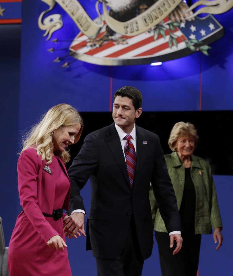 Republican vice presidential nominee Rep. Paul Ryan, of Wisconsin, center, leaves the stage with his wife, Janna, left, and his mother Betty Douglas after the vice presidential debate with Vice President Joe Biden at Centre College, Thursday, Oct. 11, 2012, in Danville, Ky. (AP Photo/David Goldman)