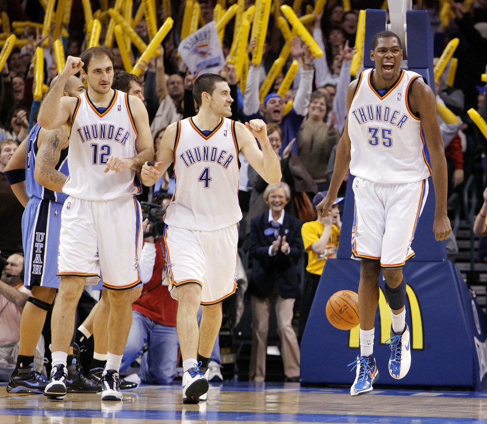 Photo - CELEBRATE / CELEBRATION: From left, Nenad Krstic (12), Nick Collison (4) and Kevin Durant (35) of Oklahoma City react at the end of the NBA basketball game between the Oklahoma City Thunder and the Utah Jazz at the Ford Center in Oklahoma City, Thursday, December 31, 2009. The Thunder won, 87-86. Photo by Nate Billings, The Oklahoman ORG XMIT: KOD