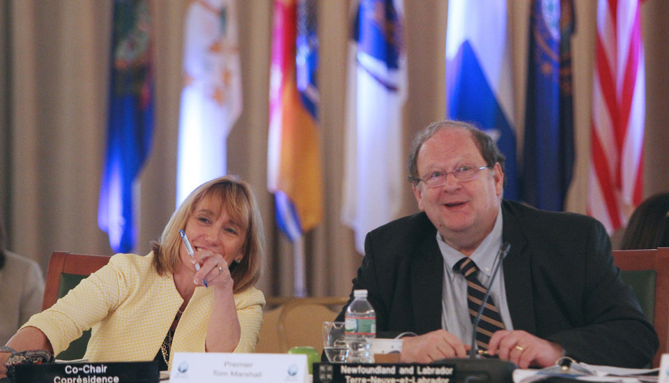 Photo - Gov. Maggie Hassan, D-N.H., left, speaks with Premier Tom Marshall of Newfoundland and Labrador at the New England Governors and eastern  Canadian Premiers 38th annual conference Monday, July 14, 2014. in Bretton Woods, N.H.  They are wrapping up a two-day meeting in New Hampshire focused on regional cooperation.   (AP Photo/Jim Cole)