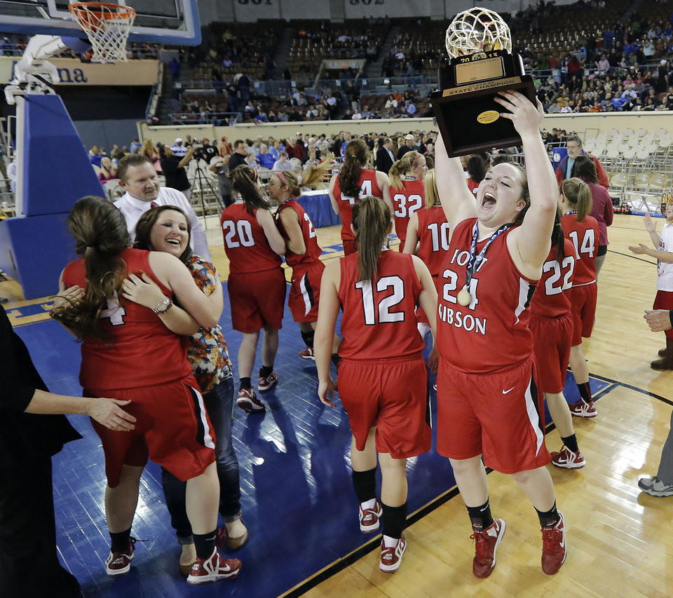 Fort Gibson's Brooke Palmer (24) celebrates with the gold ball trophy after the win over Mount Saint Mary during the state high school basketball tournament Class 4A girls championship game between Fort Gibson High School and Mount St. Mary High School at the State Fair Arena on Saturday, March 9, 2013, in Oklahoma City, Okla. Photo by Chris Landsberger, The Oklahoman
