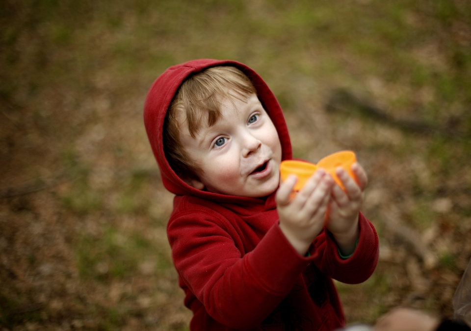 Photo - Rafe Dickerson, 3, shows an egg to his mother Kendra Dickerson of Edmond during Easter activities at Camp DaKaNi in Oklahoma City, Saturday, April 23, 2011.   Photo by Bryan Terry, The Oklahoman ORG XMIT: KOD