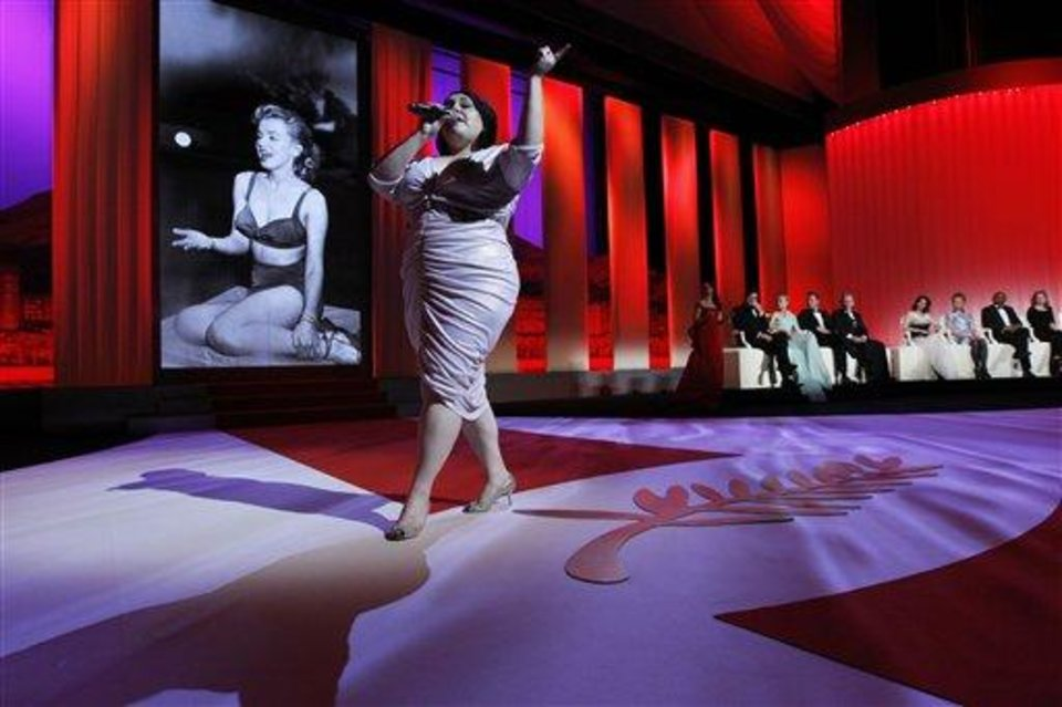 Photo - Singer Beth Ditto performs during the opening ceremony at the 65th international film festival, in Cannes, southern France, Wednesday, May 16, 2012. (AP Photo/Joel Ryan)