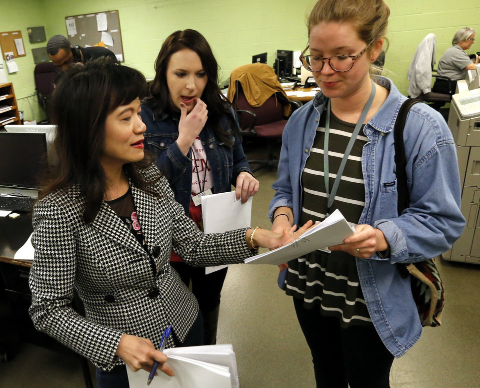Photo -  Oklahoma County District Judge Cindy Truong, left, issues Own Recognizance (OR) bonds to inmates on the weekends to help reduce the Oklahoma County jail population on Saturday in Oklahoma City. With her are outreach workers Haley Stevens and Abigail Otto. [Photo by Steve Sisney, The Oklahoman]