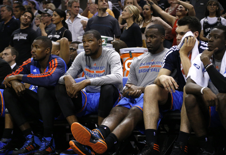 Photo - Oklahoma City's Serge Ibaka (9), Kevin Durant (35), Kendrick Perkins (5), Steven Adams (12) and Reggie Jackson (15) watch the final minutes of Game 5 of the Western Conference Finals in the NBA playoffs between the Oklahoma City Thunder and the San Antonio Spurs at the AT&T Center in San Antonio, Thursday, May 29, 2014. Photo by Sarah Phipps, The Oklahoman