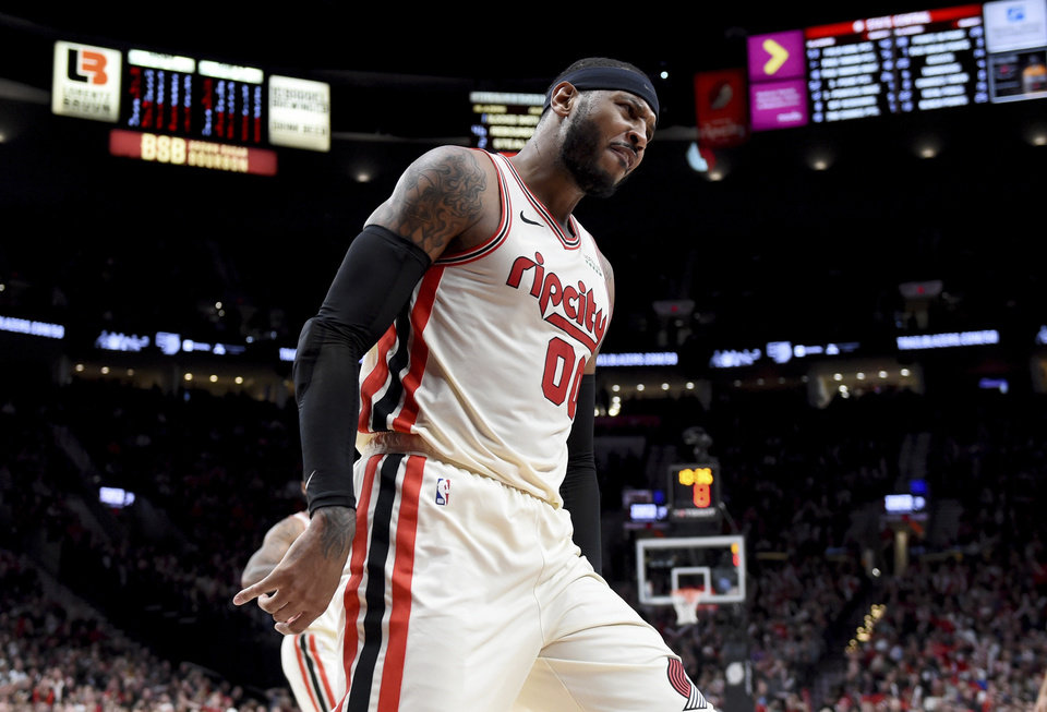 Photo - Portland Trail Blazers forward Carmelo Anthony reacts after hitting a shot during the second half of the team's NBA basketball game against the Oklahoma City Thunder in Portland, Ore., Wednesday, Nov. 27, 2019. The Blazers won 136-119. (AP Photo/Steve Dykes)