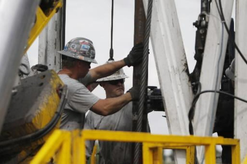 In this Tuesday, Aug. 25, 2009 file photo, crew members with Anadarko Petroleum Corp., work on a drilling platform on a Weld County farm near Mead, Colo., in the northeastern part of the state. (AP Photo/Ed Andrieski, File)