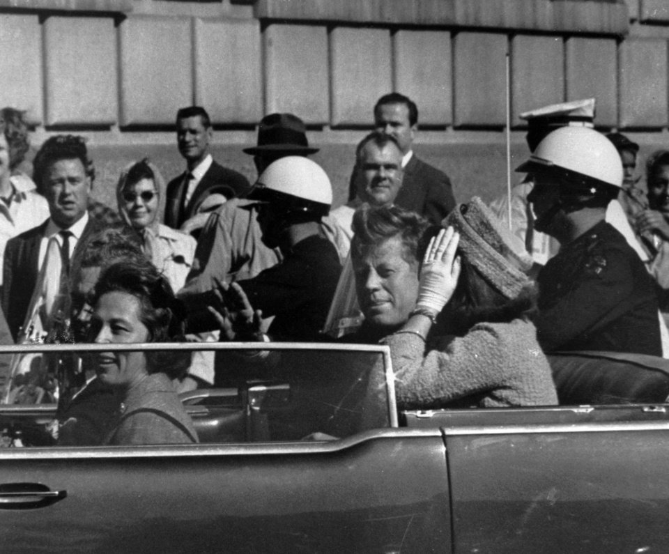 Photo - FILE - This Nov. 22, 1963 file photo shows President John F. Kennedy riding in motorcade with first lady Jacqueline Kenndy before he was shot in Dallas, Texas. The Sept. 11, 2001 terrorist attack is by far the most memorable moment shared by television viewers during the past 50 years, a study released on Wednesday, July 11, 2012 concluded. The only thing that came close was President John F. Kennedy's assassination and its aftermath in 1963, but that was only for the people aged 55 and over who experienced the events as they happened instead of replayed as an historical artifact. (AP Photo, file) ORG XMIT: NYET112