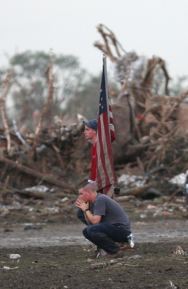 People react in front of the Plaza Towers Elementary School in Moore following a deadly tornado, Monday, May 20, 2013. Photo by Sarah Phipps, The Oklahoman