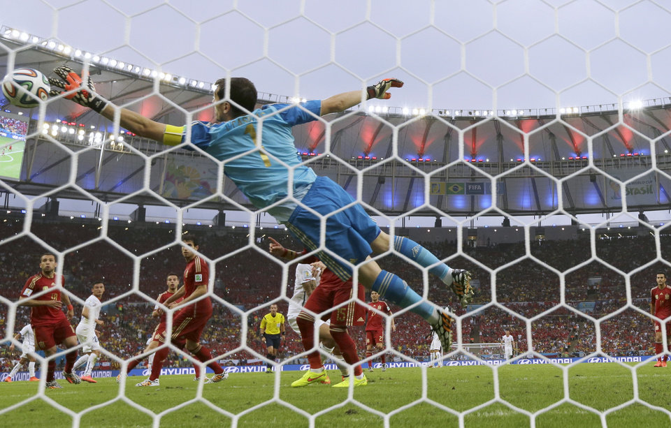 Photo - Spain's goalkeeper Iker Casillas fails to make a save as Chile's Charles Aranguiz scores his side's 2nd goal during the group B World Cup soccer match between Spain and Chile at the Maracana Stadium in Rio de Janeiro, Brazil, Wednesday, June 18, 2014.  (AP Photo/Manu Fernandez)