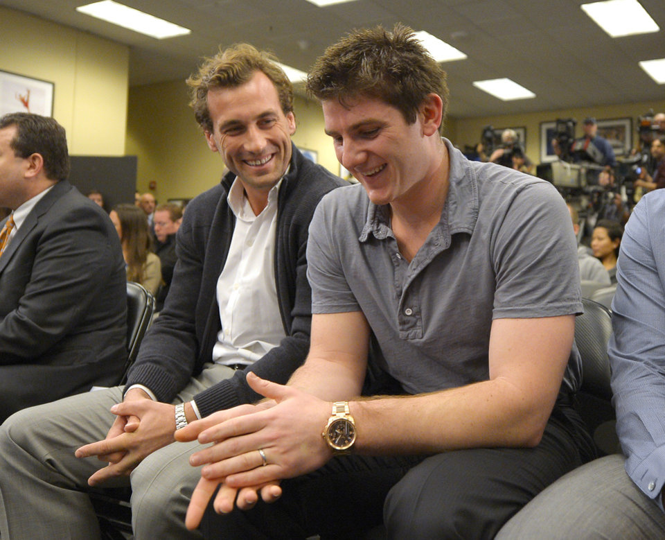 Photo - Los Angeles Kings players Jarret Stoll, left, and Jonathan Quick smile during a news conference to help kick off the club's 2012-13 regular season on Thursday, Jan. 10, 2013, in Los Angeles. (AP Photo/Mark J. Terrill)