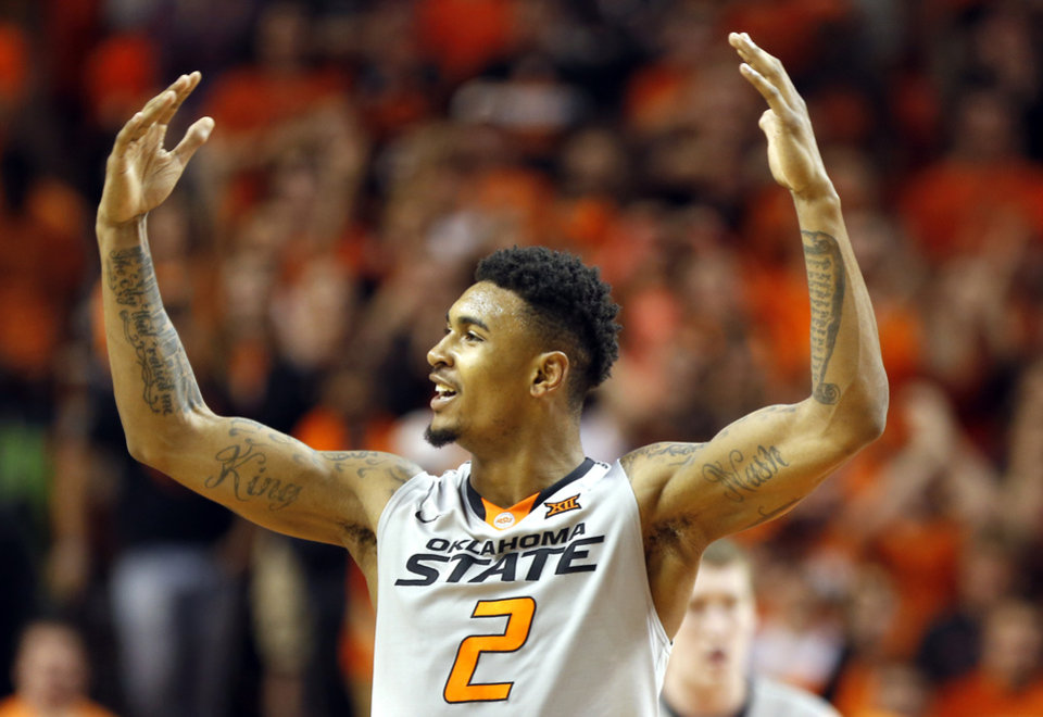 Photo - Oklahoma State's Le'Bryan Nash (2) celebrates during the men's college basketball game between Oklahoma State University and the University of Kansas at Gallagher-Iba Arena in Stillwater, Okla.,  Saturday, Feb. 7, 2015. OSU won 67-62. Photo by Sarah Phipps, The Oklahoman