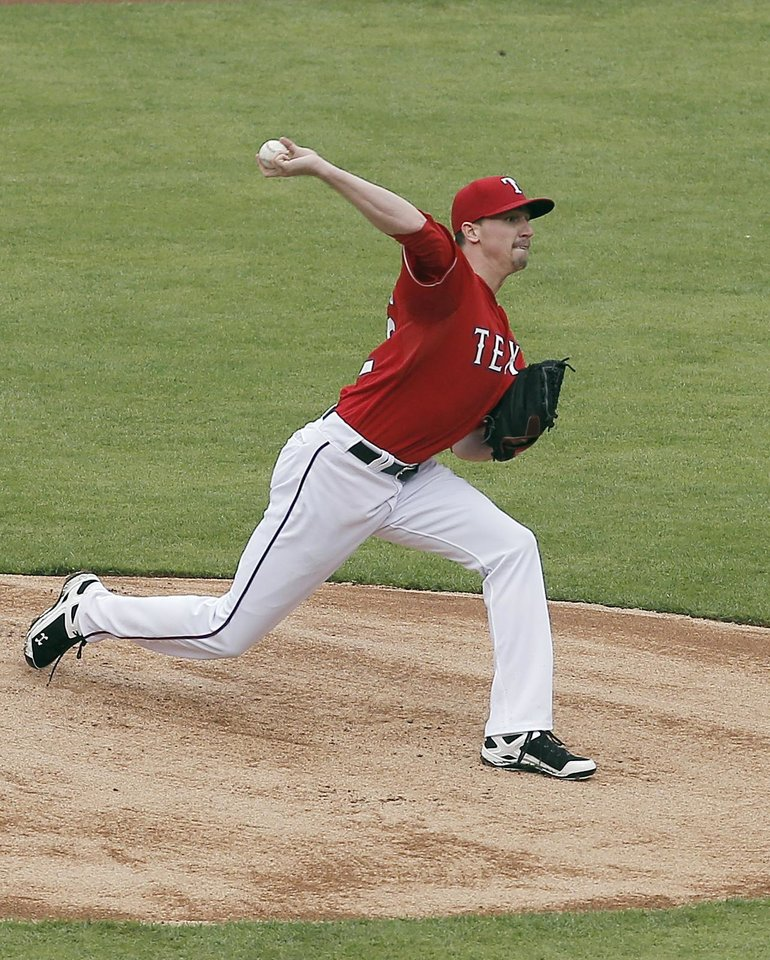 Photo - Texas Rangers starting pitcher Tanner Scheppers (52) throws during the first inning of a baseball game against the Seattle Mariners, Thursday, April 17, 2014, in Arlington, Texas. (AP Photo/Brandon Wade)