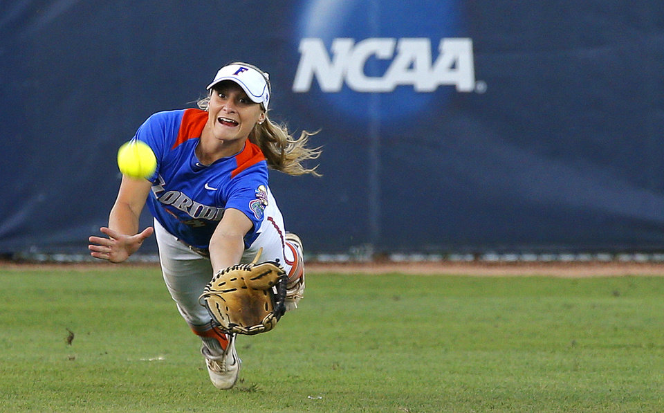 Florida's Kristi Merritt leaps for the ball in the seventh inning against Nebraska in their Women's College World Series softball game between at ASA Hall of Fame Stadium in Oklahoma City, Saturday, June, 1, 2013. Merritt was unable to hold onto the ball for an out.  Photo by Bryan Terry, The Oklahoman