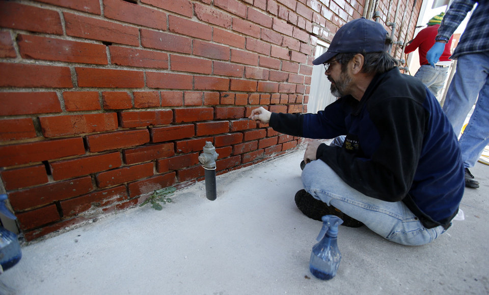 Lloyd Bumm prepares a wall for new mortar during a masonry repair workshop Saturday in downtown Norman. PHOTO BY STEVE SISNEY, THE OKLAHOMAN <strong>STEVE SISNEY</strong>