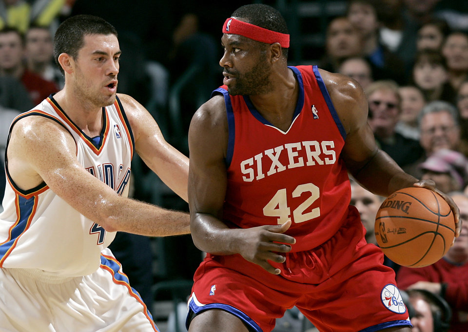 Photo - Oklahoma City's Nick Collison guards Philadelphia's Elton Brand during the second half of their NBA basketball game at the Ford Center in Oklahoma City on Tuesday, Dec. 2, 2009. The Thunder beat the 76ers 117 to 106. By John Clanton, The Oklahoman