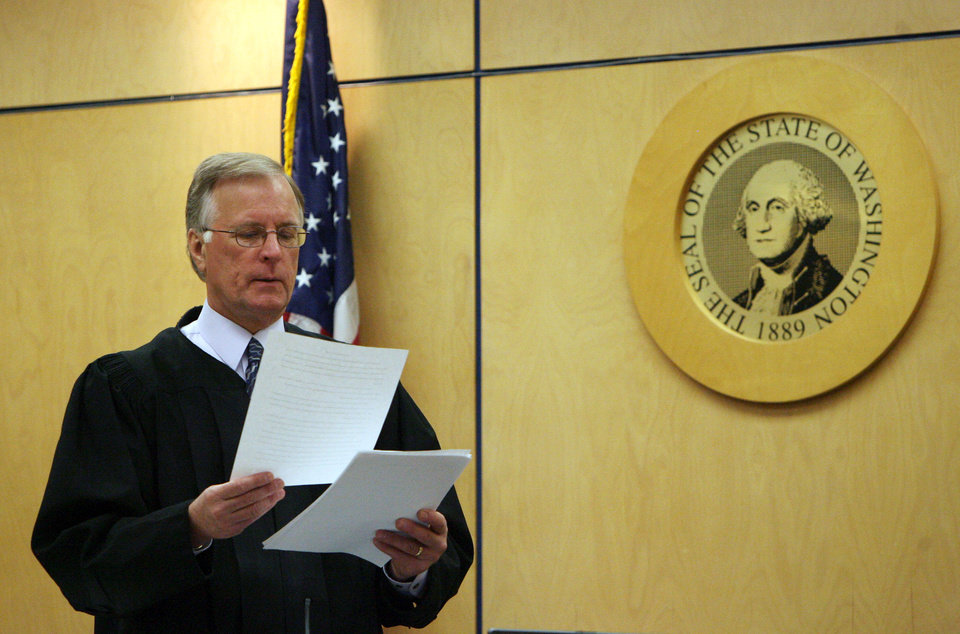 Photo -   Judge Ronald Culpepper reads instructions to the jury in the voyeurism trial of Steve Powell, Tuesday, May 15, 2012, in Tacoma, Wash. Powell is the father-in-law of missing Utah mother Susan Powell. (AP Photo/The Salt Lake Tribune, Steve Griffin) DESERET NEWS OUT; LOCAL TV OUT; MAGS OUT