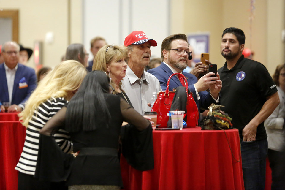 Photo - Supporters watch during a Republican Party election night watch party in Edmond, Tuesday, Nov. 3, 2020. [Bryan Terry/The Oklahoman]