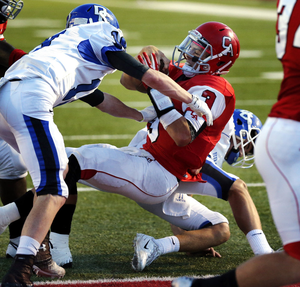 Carl Albert's Stevie Thompson carries into the end zone during a high school football game between the Carl Albert Titans and the Deer Creek Antlers on Friday, Sept. 27, 2013 in Midwest City, Okla. Photo by Steve Sisney, The Oklahoman