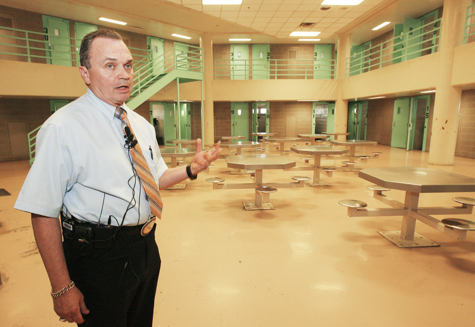 Photo - OKLAHOMA COUNTY JAIL: Sheriff John Whetsel takes members of the media on a tour of the jail after a press conference regarding a 148 page report from the Department of Justice, Monday, August 4, 2008.  The empty unit held federal prisoners until last Saturday.  Photo by David McDaniel, The Oklahoman  ORG XMIT: KOD