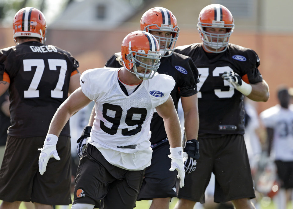Cleveland Browns linebacker Paul Kruger (99) chases a play during drills at the NFL football team's facility in Berea, Ohio, Friday, July 26, 2013. (AP Photo/Mark Duncan)
