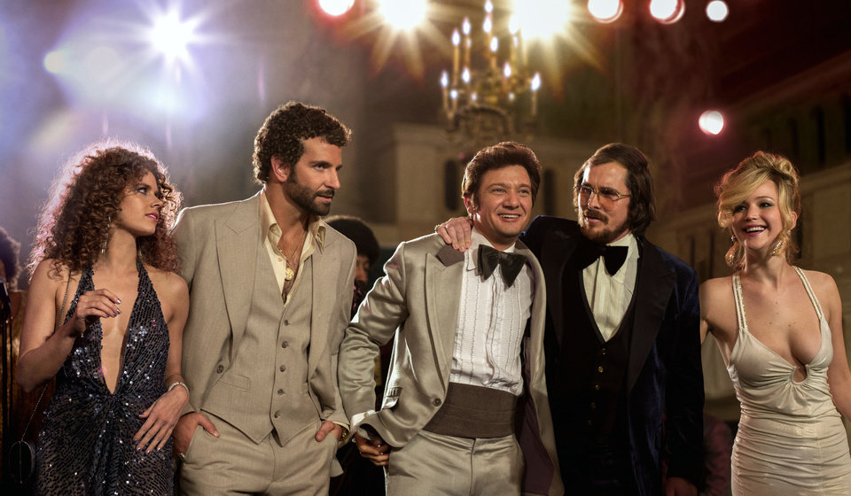 "This film image released by Sony Pictures shows, from left,  Amy Adams, Bradley Cooper, Jeremy Renner, Christian Bale and Jennifer Lawrence in a scene from ""American Hustle."" While shooting in Boston, David O. Russell��s upcoming fictionalization of the Abscam investigation, ��American Hustle,�� found itself caught up in the Boston Marathon bombing. When the city was essentially shut down for the manhunt, the production had to be stopped for a day. The experience, Russell says, was felt closely by the production. (AP Photo/Sony - Columbia Pictures, Francois Duhamel)"