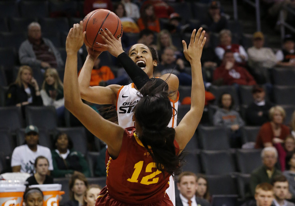 Photo - Oklahoma State guard Tiffany Bias (3) fouls Iowa State guard Seanna Johnson (12) as she shoots in the first half of an NCAA college basketball game in the quarterfinals of the Big 12 Conference women's basketball tournament in Oklahoma City, Saturday, March 8, 2014. (AP Photo/Sue Ogrocki)