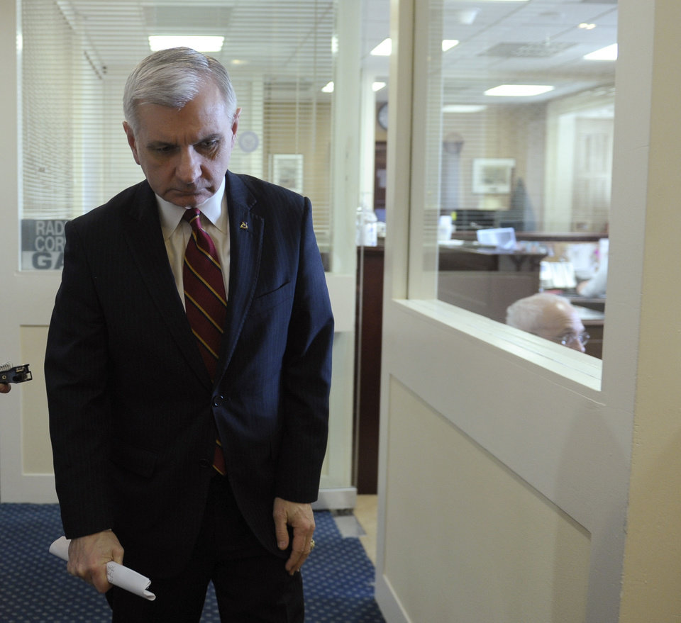 Photo - Sen. Jack Reed, D-R.I., leaves following a news conference to discuss unemployment insurance, Thursday, Feb. 6, 2014, on Capitol Hill in Washington. (AP Photo/Susan Walsh)