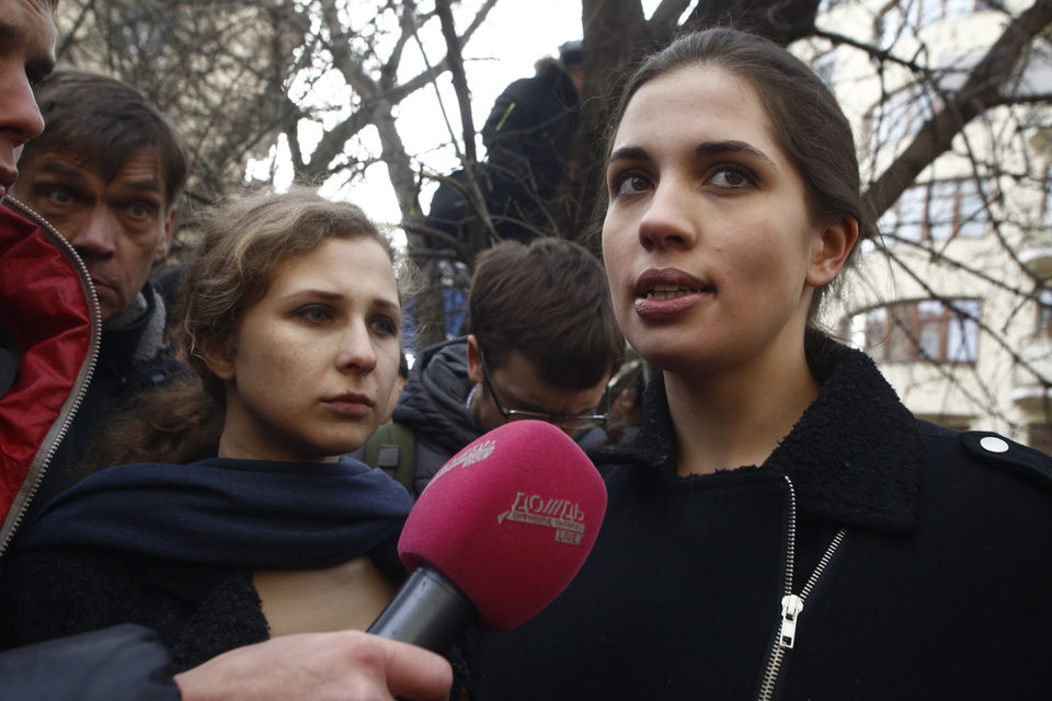 Photo - Members of the Pussy Riot punk group, Nadezhda Tolokonnikova, right, and Maria Alekhina speak to the media outside Zamoskvoretsky District Court in Moscow, Russia, Friday, Feb. 21, 2014.  The court on Friday is to deliver a verdict in the trial of eight defendants facing charges for their role in a protest in Moscow on May 6 2012 that ended in violent clashes with police. (AP Photo/Denis Tyrin)