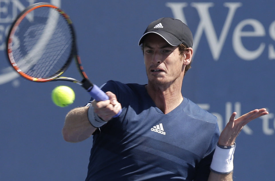 Photo - Andy Murray, from Great Britain, hits a forehand against Joao Sousa, from Portugal, during a match at the Western & Southern Open tennis tournament, Wednesday, Aug. 13, 2014, in Mason, Ohio. Murray won 6-3, 6-3. (AP Photo/Al Behrman)