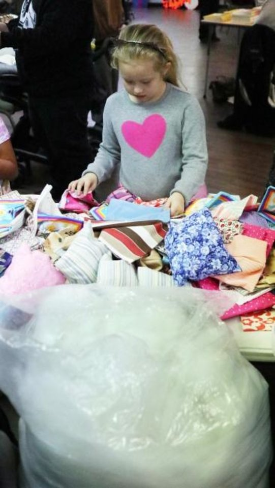 Photo -  Jasmine Andrews, 8, picks out fabric for her