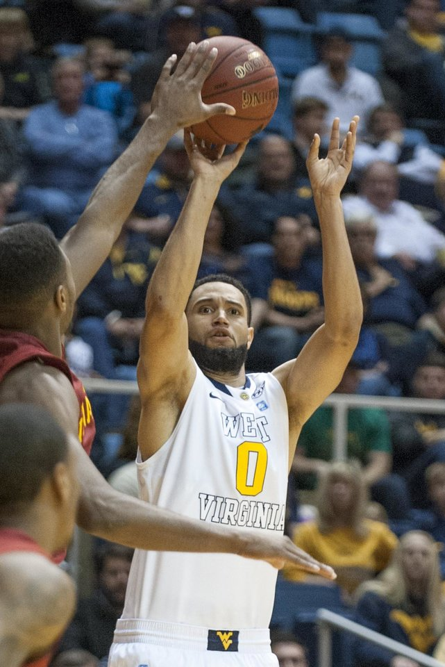 West Virginia's Remi Dibo (0) looks to shoot during the second half of an NCAA college basketball game against Iowa State, Monday, Feb. 10, 2014, in Morgantown, W.Va. West Virginia won 102-77. (AP Photo/Andrew Ferguson)