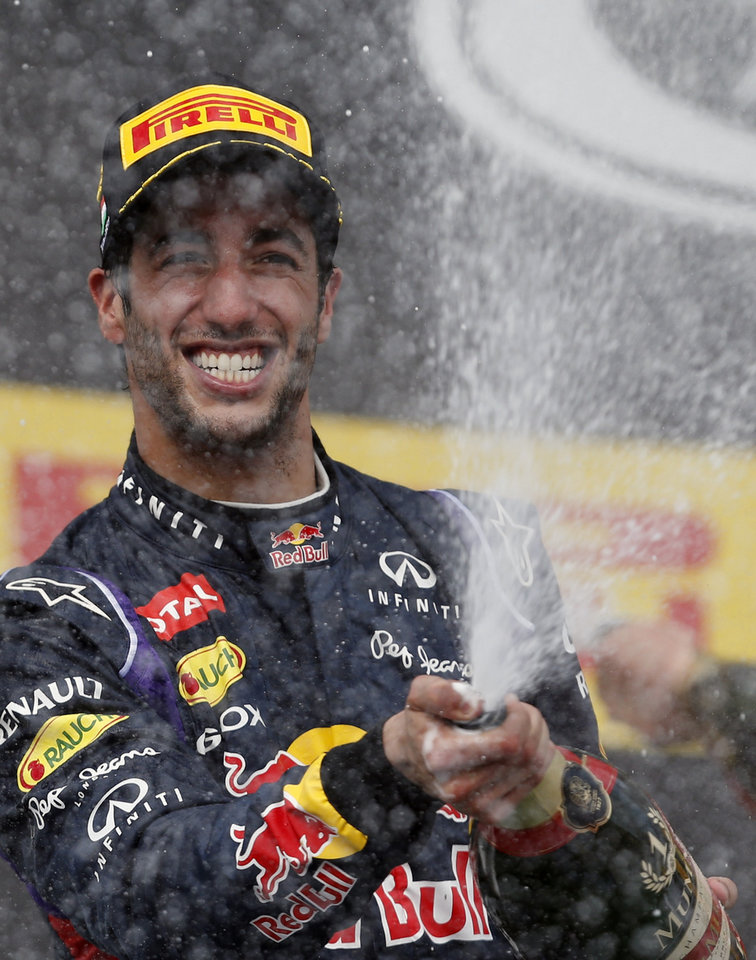 Photo - Red Bull driver Daniel Ricciardo of Australia celebrates after winning the Hungarian Formula One Grand Prix in Budapest, Hungary, Sunday, July 27, 2014. (AP Photo/Darko Vojinovic)